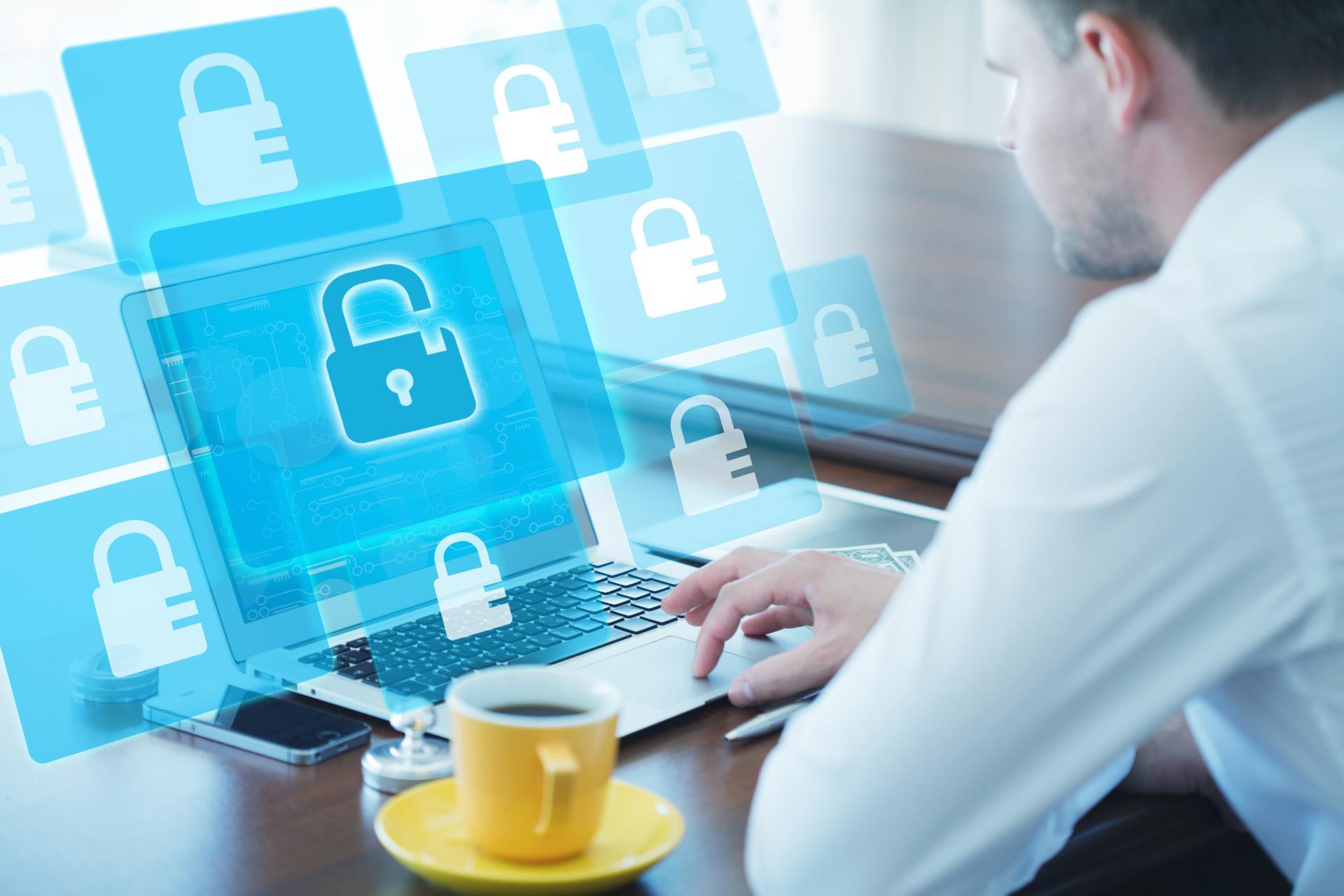 Man at laptop with lock symbol on screen