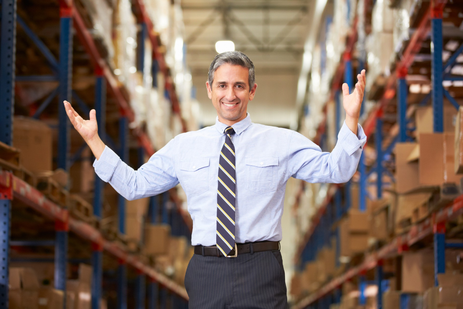 Man standing in warehouse.